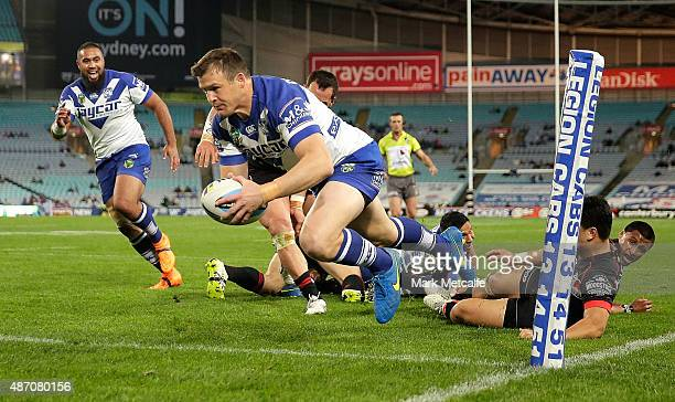 Josh Morris of the Bulldogs scores a try during the round 26 NRL match between the Canterbury Bulldogs and the New Zealand Warriors at ANZ Stadium on...