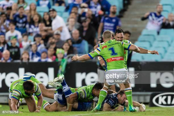 Josh Morris of the Bulldogs scores a try during the round nine NRL match between the Canterbury Bulldogs and the Canberra Raiders at ANZ Stadium on...