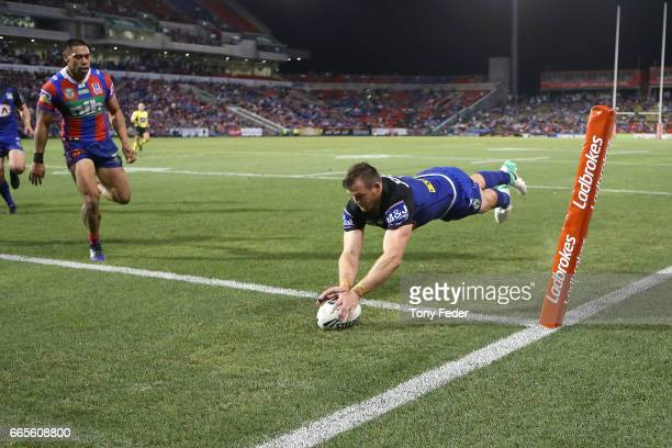 Josh Morris of the Bulldogs scores a try during the round six NRL match between the Newcastle Knights and the Canterbury Bulldogs at McDonald Jones...