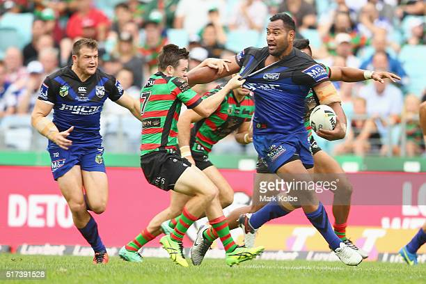 Josh Morris of the Bulldogs waits for a pass from Tony Williams of the Bulldogs as he is tackled by Luke Keary of the Rabbitohs during the round four...
