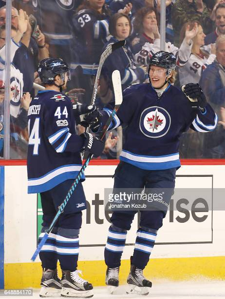 Josh Morrissey and Patrik Laine of the Winnipeg Jets celebrate a first period goal against the San Jose Sharks at the MTS Centre on March 6 2017 in...