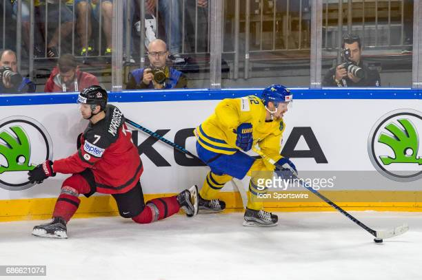 Josh Morrissey clashes with Joakim Nordstrom during the Ice Hockey World Championship Gold medal game between Canada and Sweden at Lanxess Arena in...