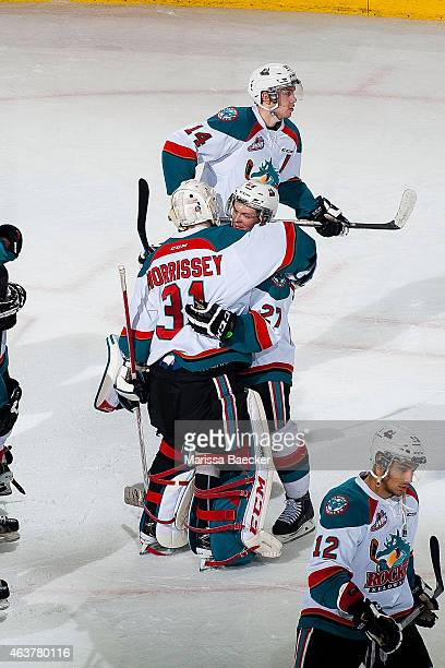 Josh Morrissey congratulates younger brother Jake Morrissey of Kelowna Rockets on the shut out against the Moose Jaw Warriors on February 14 2015 at...