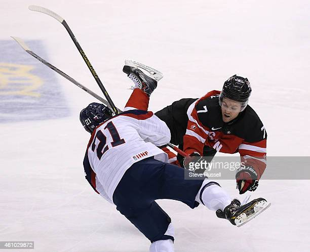 TORONTO ON JANUARY 4 Josh Morrissey hits David Soltes in the open ice as Team Canada plays Team Slovakia in the semi final round of the IIHF World...