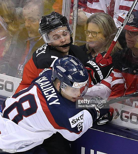 TORONTO ON JANUARY 4 Josh Morrissey is checked by Pavol Skalicky as Team Canada plays Team Slovakia in the semi final round of the IIHF World Junior...