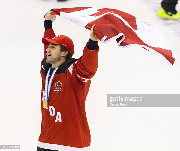 Josh Morrissey of Canada celebrates with the flag after a 54 win against Russia during the Gold medal game of the 2015 IIHF World Junior Championship...