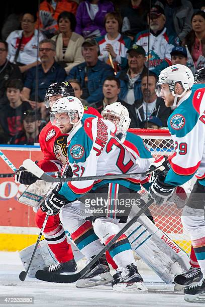 Josh Morrissey of Kelowna Rockets checks Oliver Bjorkstrand of Portland Winterhawks during game 5 of the Western Conference Final on May 1 2015 at...