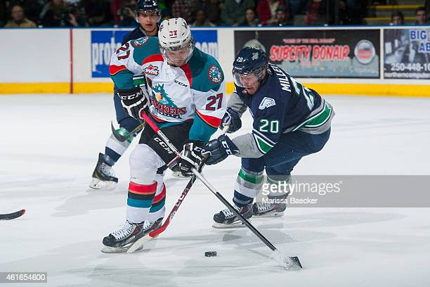 Josh Morrissey of Kelowna Rockets skates with the puck as Cory Millette of Seattle Thunderbirds back checks during first period on January 16 2015 at...