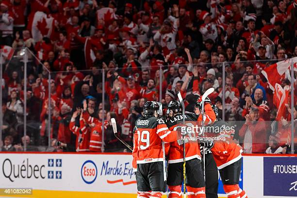 Josh Morrissey of Team Canada celebrates his goal with teammates in a preliminary round game at the 2015 IIHF World Junior Hockey Championships...