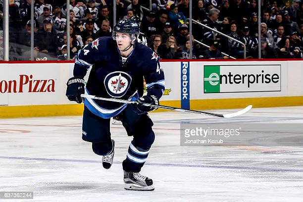 Josh Morrissey of the Winnipeg Jets follows the play down the ice during second period action against the Columbus Blue Jackets at the MTS Centre on...