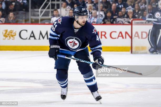 Josh Morrissey of the Winnipeg Jets follows the play down the ice during second period action against the Pittsburgh Penguins at the MTS Centre on...