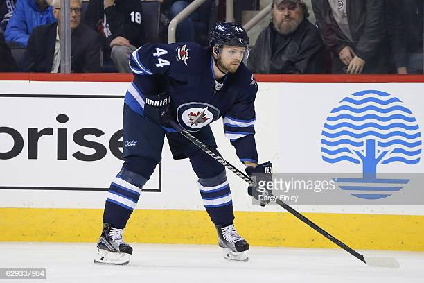 Josh Morrissey of the Winnipeg Jets gets set for a first period faceoff against the Detroit Red Wings at the MTS Centre on December 6 2016 in...