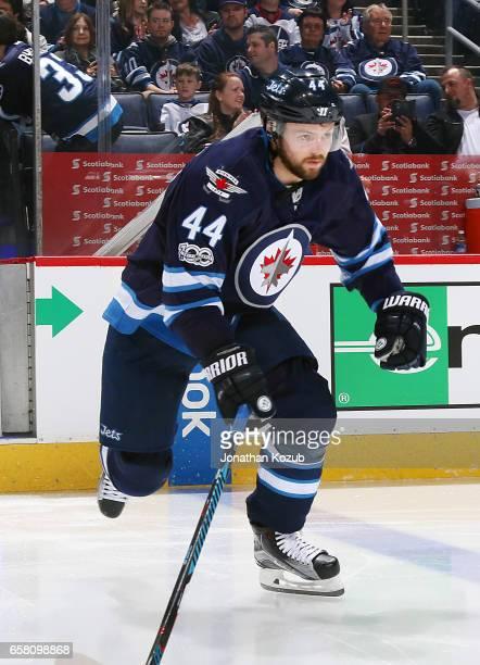 Josh Morrissey of the Winnipeg Jets hits the ice prior to puck drop against the Vancouver Canucks at the MTS Centre on March 26 2017 in Winnipeg...