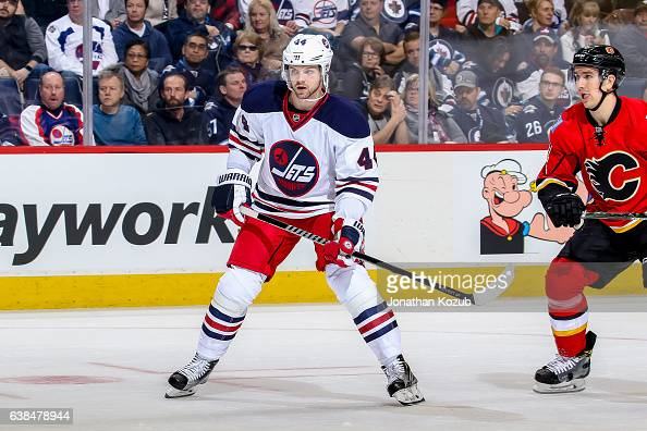 Josh Morrissey of the Winnipeg Jets keeps an eye on the play during first period action against the Calgary Flames at the MTS Centre on January 9...