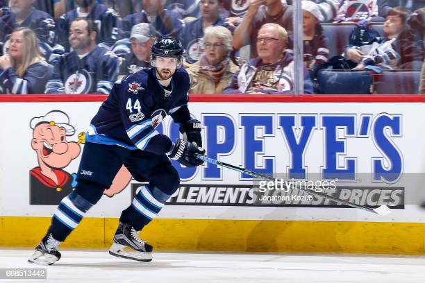 Josh Morrissey of the Winnipeg Jets keeps an eye on the play during third period action against the Nashville Predators at the MTS Centre on April 8...