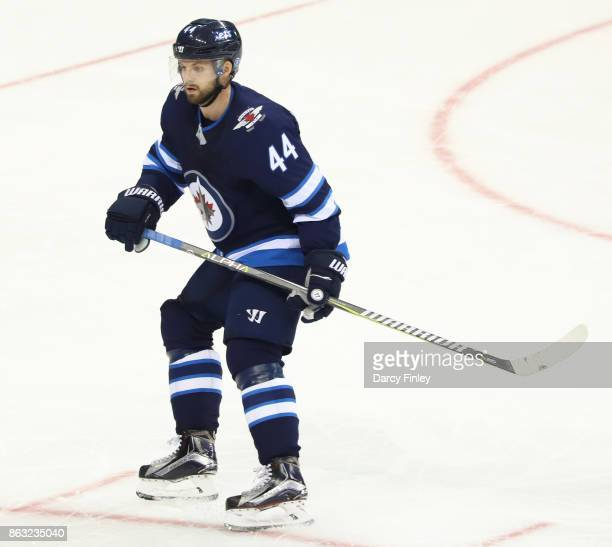 Josh Morrissey of the Winnipeg Jets keeps an eye on the play during second period action against the Carolina Hurricanes at the Bell MTS Place on...