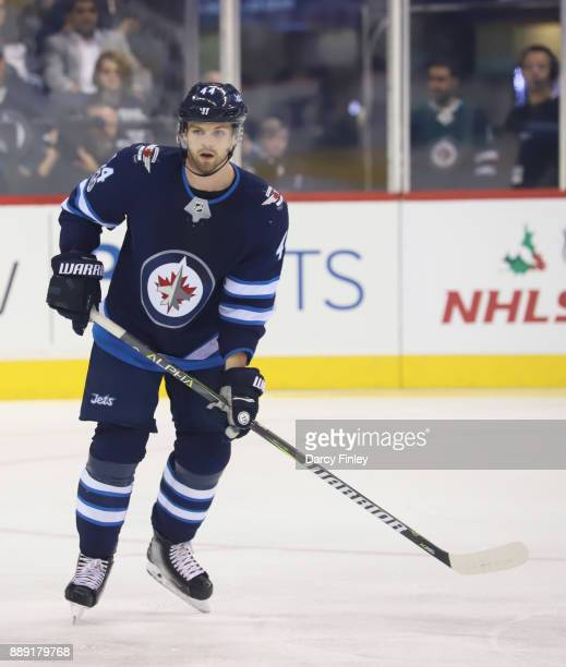 Josh Morrissey of the Winnipeg Jets keeps an eye on the play during first period action against the Ottawa Senators at the Bell MTS Place on December...