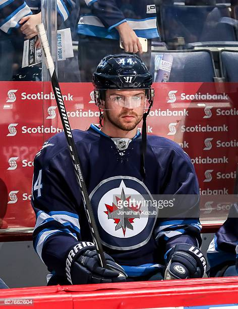 Josh Morrissey of the Winnipeg Jets looks on from the bench prior to puck drop against the Nashville Predators at the MTS Centre on November 27 2016...
