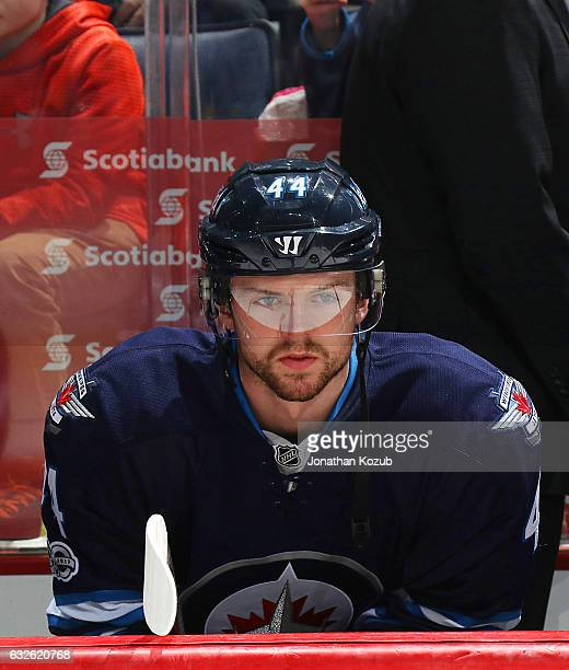 Josh Morrissey of the Winnipeg Jets looks on from the bench prior to puck drop against the San Jose Sharks at the MTS Centre on January 24 2017 in...