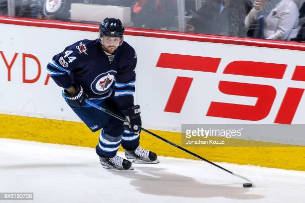 Josh Morrissey of the Winnipeg Jets plays the puck along the boards during third period action against the Dallas Stars at the MTS Centre on February...