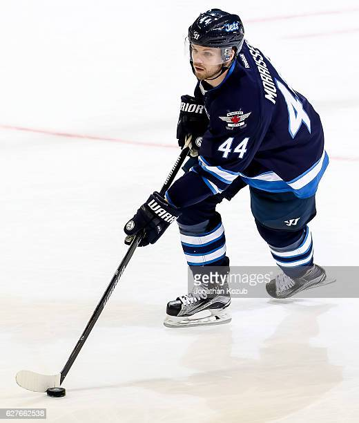Josh Morrissey of the Winnipeg Jets plays the puck down the ice during third period action against the Nashville Predators at the MTS Centre on...