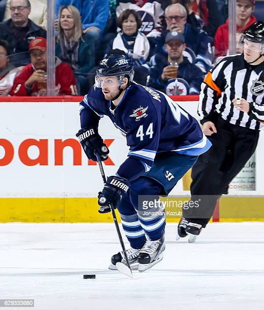 Josh Morrissey of the Winnipeg Jets plays the puck down the ice during second period action against the Detroit Red Wings at the MTS Centre on...