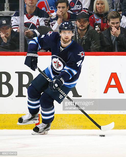 Josh Morrissey of the Winnipeg Jets plays the puck up the ice during second period action against the Colorado Avalanche at the MTS Centre on...