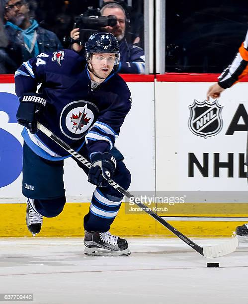 Josh Morrissey of the Winnipeg Jets plays the puck up the ice during third period action against the New York Islanders at the MTS Centre on December...