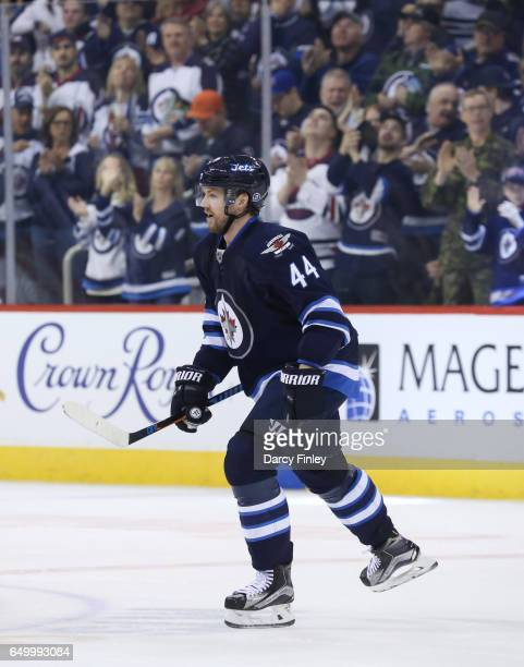 Josh Morrissey of the Winnipeg Jets skates back to the bench after scoring a first period goal against the San Jose Sharks at the MTS Centre on March...