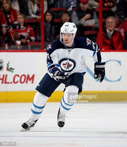 Josh Morrissey of the Winnipeg Jets skates for position on the ice during an NHL game against the Carolina Hurricanes on November 20 2016 at PNC...