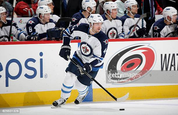 Josh Morrissey of the Winnipeg Jets skates with the puck during an NHL game against the Winnipeg Jets on November 20 2016 at PNC Arena in Raleigh...