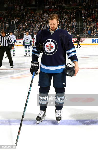 Josh Morrissey of the Winnipeg Jets stands on the ice during the singing of 'O Canada' prior to puck drop against the Vancouver Canucks at the MTS...