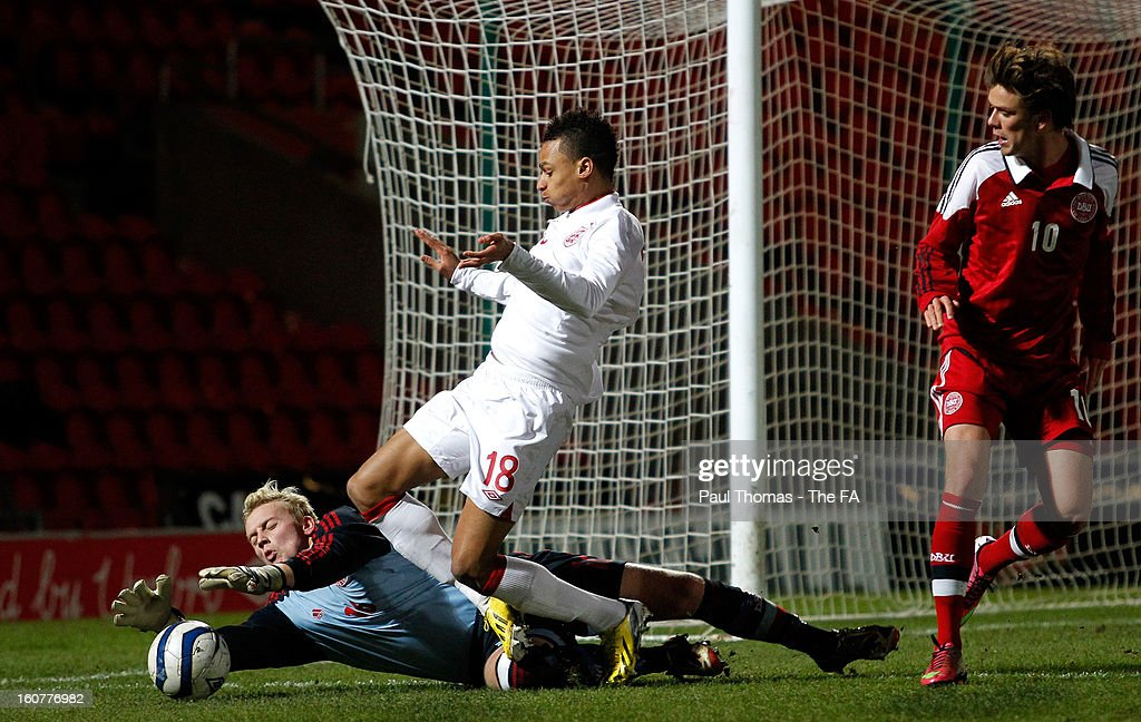 Josh Murphy (C) of England U19 in action with Oliver Korch of Denmark during the International U19 match between England and Scotland at the Keepmoat Stadium on February 5, 2013 in Doncaster, England.