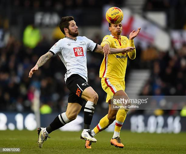 Josh Murphy of MK Dons battles with Jacob Butterfield of Derby County during the Sky Bet Championship match between Derby County and Milton Keynes...