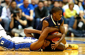 Josh Newkirk of the Pittsburgh Panthers and Justise Winslow of the Duke Blue Devils go after a ball during their game at Cameron Indoor Stadium on...