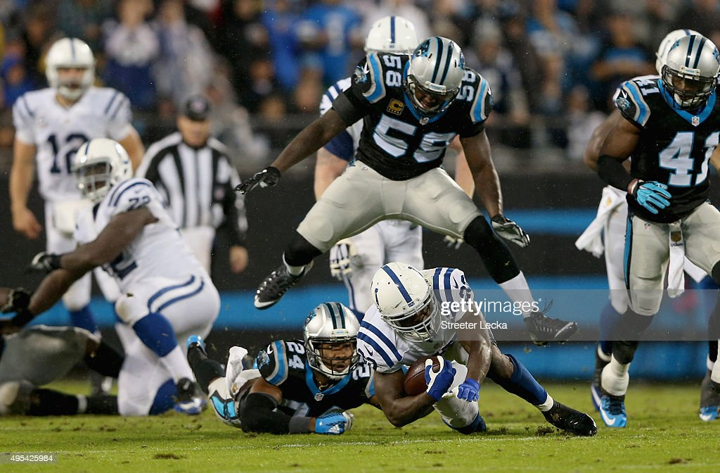 Josh Norman and teammate Thomas Davis of the Carolina Panthers tackle Frank Gore of the Indianapolis Colts in the 1st half during their game at Bank...