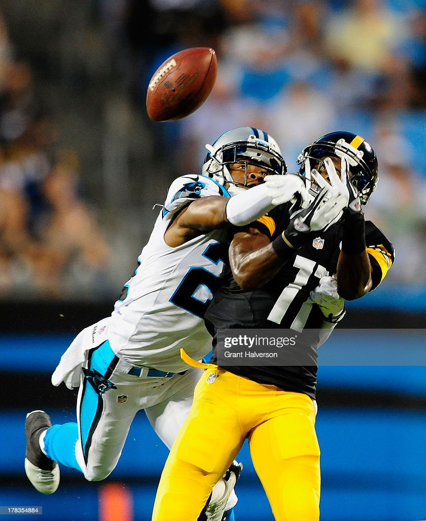 Josh Norman #24 of the Carolina Panthers defends a pass intended for Markus Wheaton #11 of the Pittsburgh Steelers during a preseason NFL game at Bank of America Stadium on August 29, 2013 in Charlotte, North Carolina.