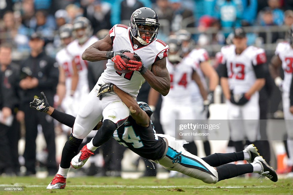 Josh Norman of the Carolina Panthers dives after Julio Jones of the Atlanta Falcons in the 3rd quarter during their game at Bank of America Stadium...