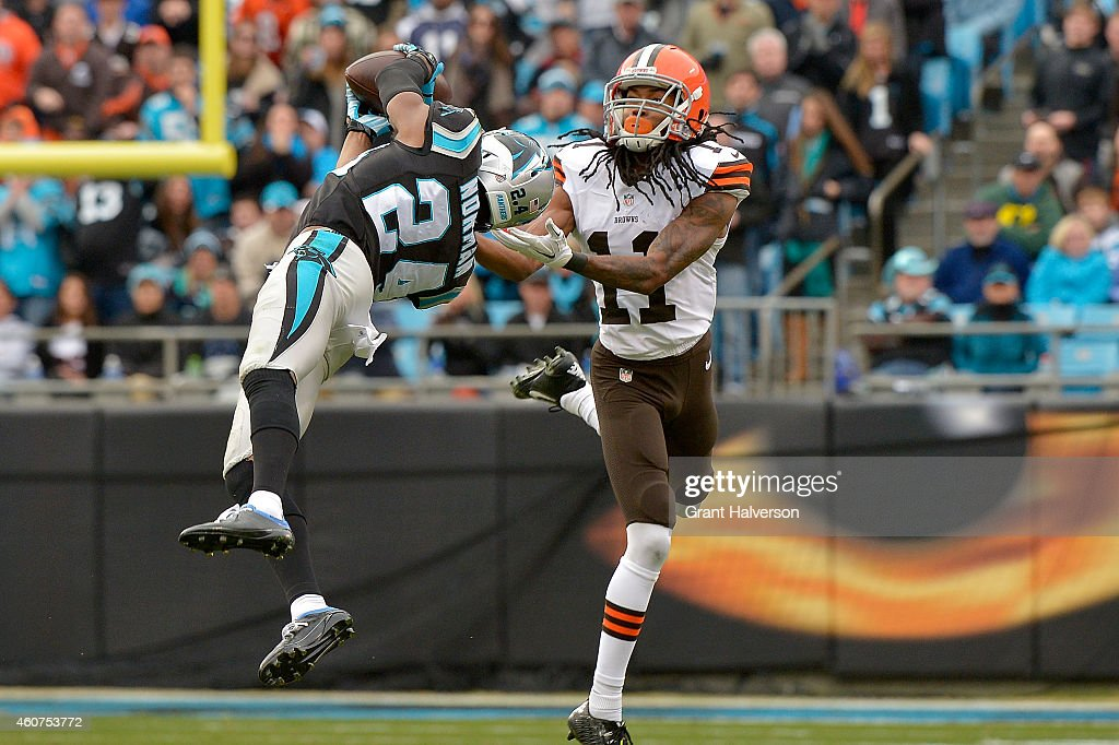 Josh Norman of the Carolina Panthers intercepts a pass intended for Travis Benjamin of the Cleveland Browns during their game at Bank of America...