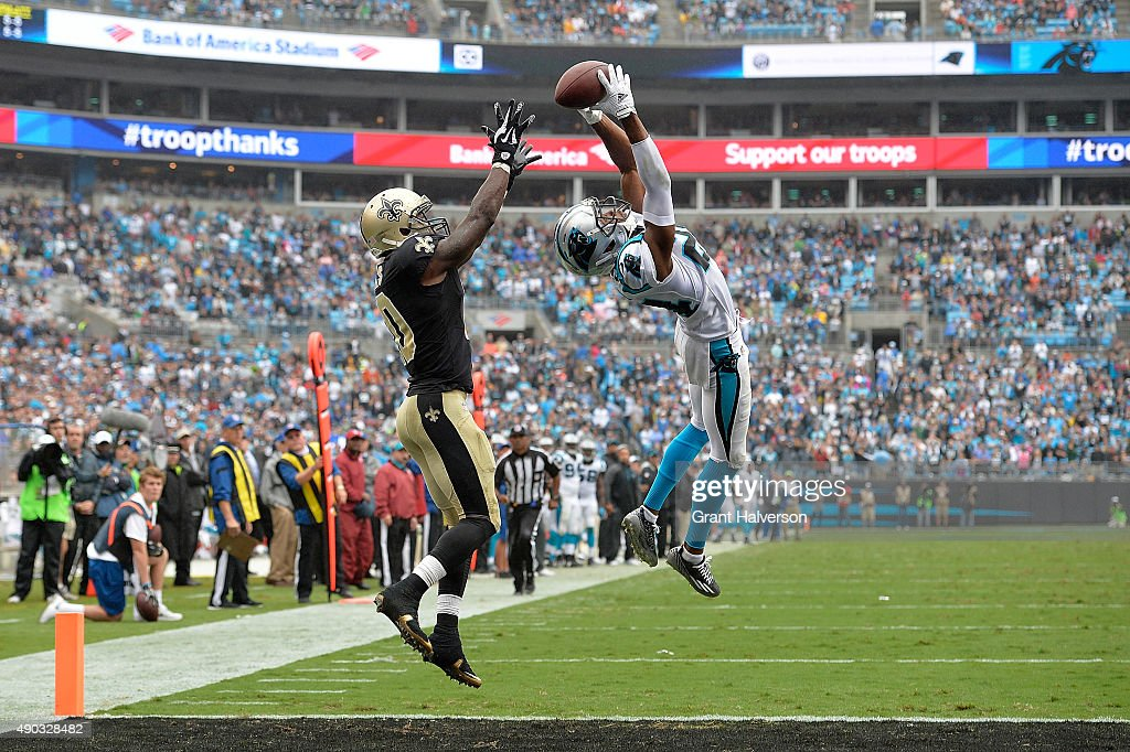 Josh Norman of the Carolina Panthers makes a gamesaving interception of a pass to Brandin Cooks of the New Orleans Saints in the end zone during...
