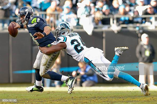 Josh Norman of the Carolina Panthers sacks Russell Wilson of the Seattle Seahawks in the 2nd half during the NFC Divisional Playoff Game at Bank of...