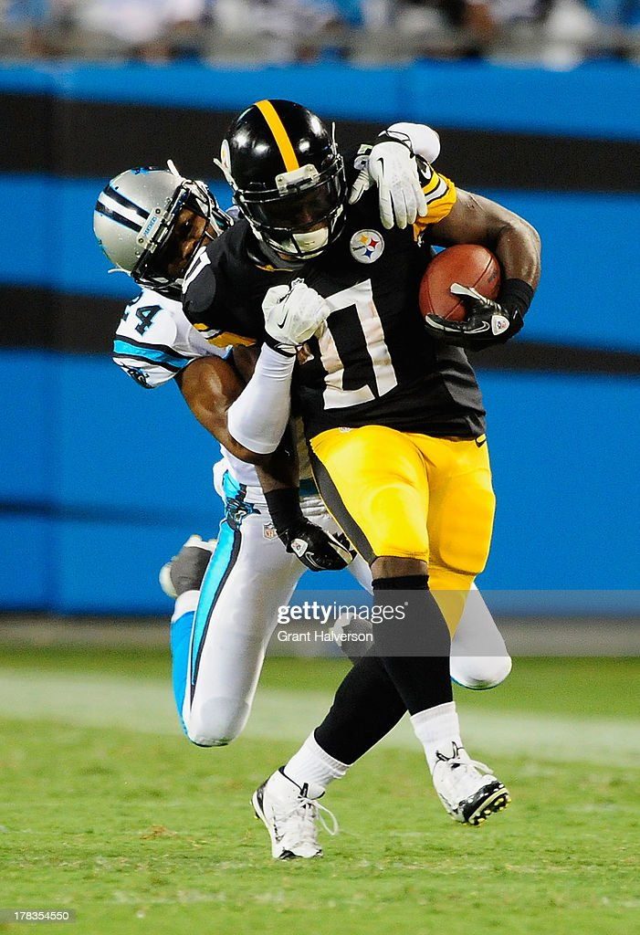 Josh Norman #24 of the Carolina Panthers tackles Jonathan Dwyer #21 of the Pittsburgh Steelers during a preseason NFL game at Bank of America Stadium on August 29, 2013 in Charlotte, North Carolina.