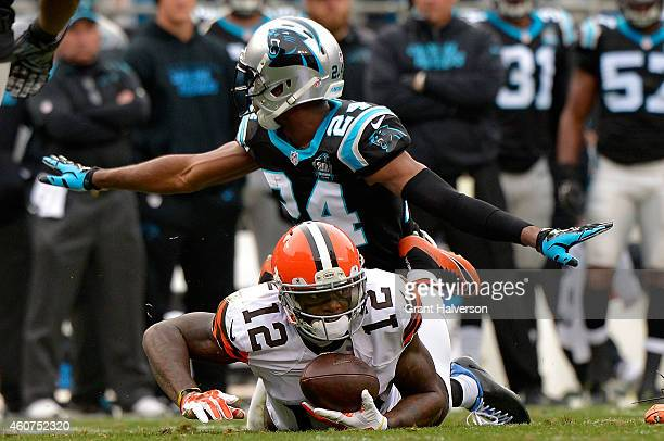 Josh Norman of the Carolina Panthers tackles Josh Gordon of the Cleveland Browns in the 1st half during their game at Bank of America Stadium on...