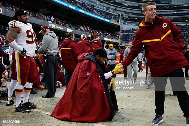 Josh Norman of the Washington Redskins reacts with a staff member on the sidelines in the fourth quarter against the Chicago Bears at Soldier Field...