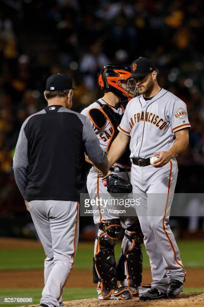Josh Osich of the San Francisco Giants is relieved by manager Bruce Bochy during the sixth inning against the Oakland Athletics at the Oakland...