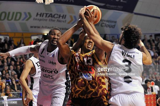 Josh Owens of Umana competes with Dexter Pittman and Michele Vitali of Obiettivo Lavoro during the LegaBasket match between Reyer Umana Venezia and...