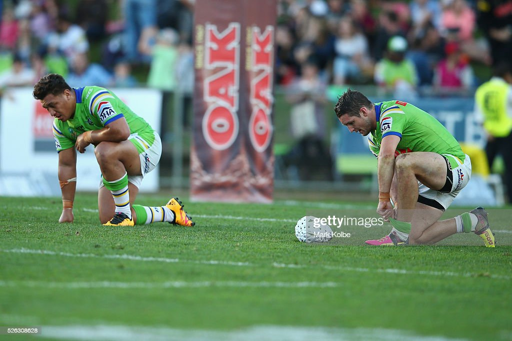 Josh Papalii and Jarrod Croker of the Raiders look dejected after defeat during the round nine NRL match between the Penrith Panthers and the Canberra Raiders at Carrington Park on April 30, 2016 in Bathurst, Australia.