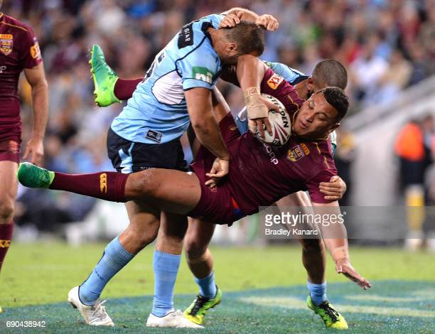 Josh Papalii of the Maroons is picked up in the tackle during game one of the State Of Origin series between the Queensland Maroons and the New South...
