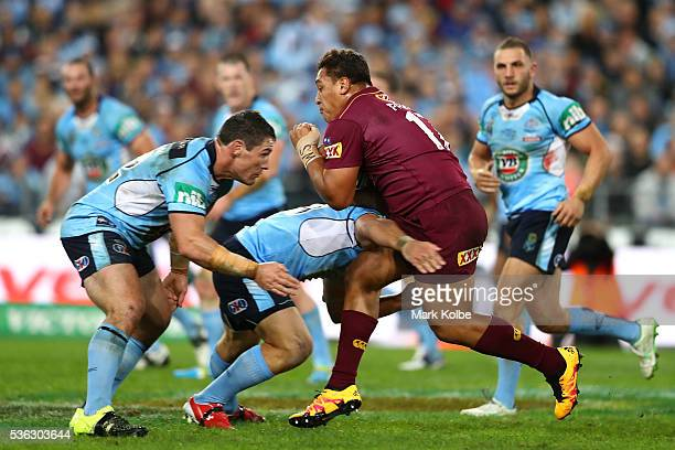 Josh Papalii of the Maroons is tackled during game one of the State Of Origin series between the New South Wales Blues and the Queensland Maroons at...