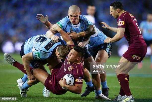 Josh Papalii of the Maroons is tackled during game two of the State Of Origin series between the New South Wales Blues and the Queensland Maroons at...